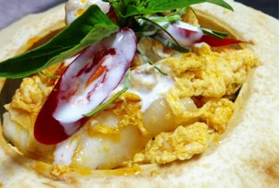 Steamed seafood with curry paste and coconut.