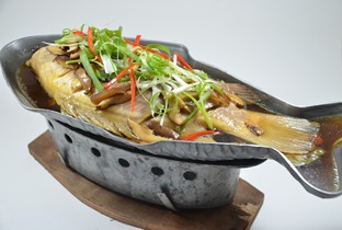 Steamed whole fish with soy sauce.